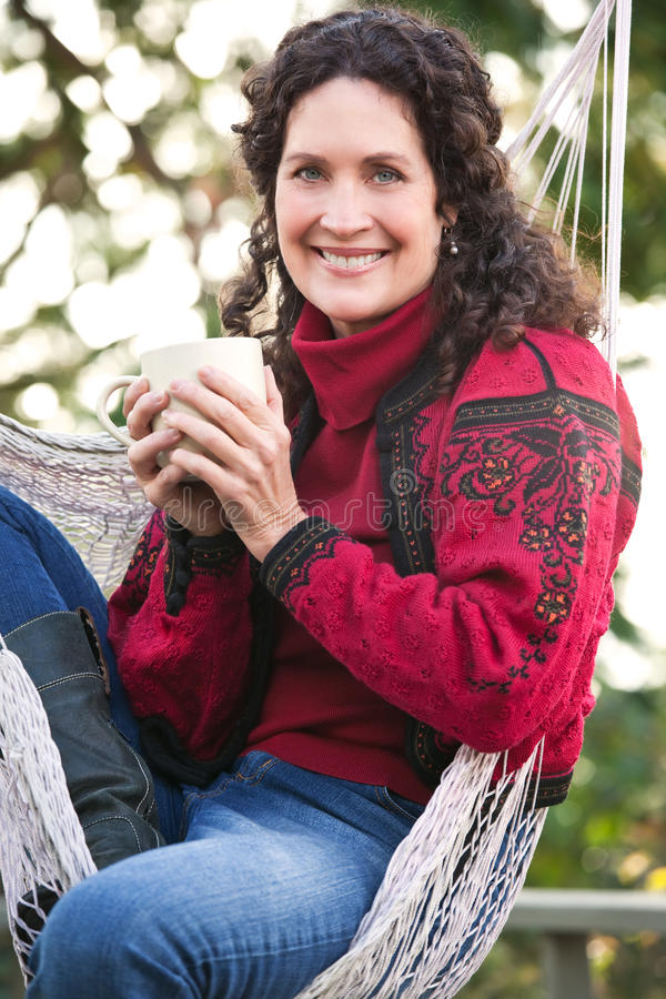 Mature woman drinking coffee stock photography