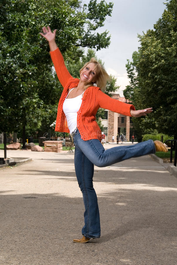 Mature woman excited to be back in college stock images