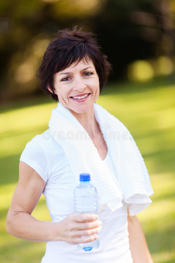 Download Mature Woman After Exercise Stock Photo - Image of happy, drink: 26833344