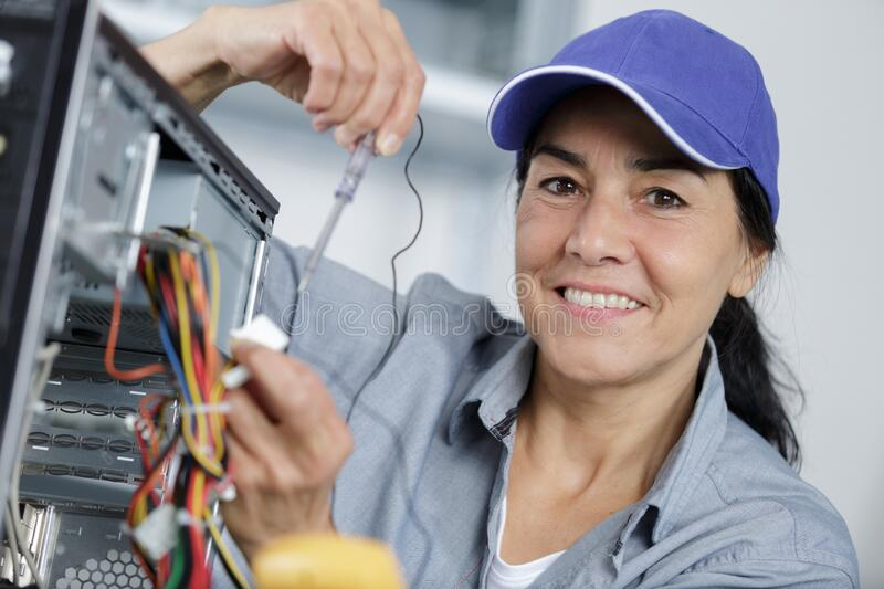 Mature woman fix pc component in service center royalty free stock image