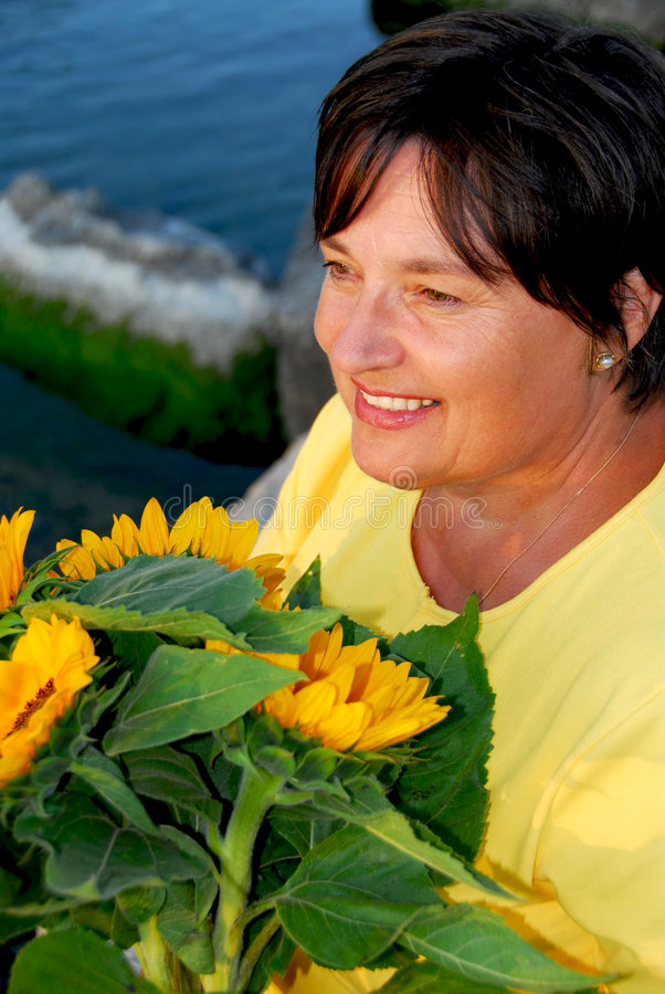 Mature woman flowers royalty free stock photography