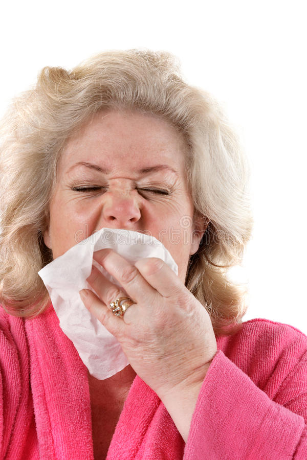 Mature woman with flu sneezing stock photo