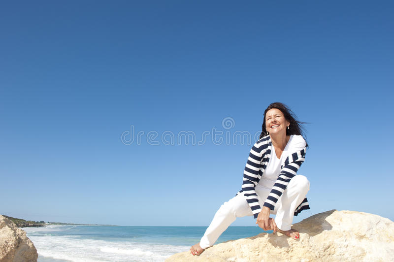 Mature woman fun ocean background royalty free stock photo