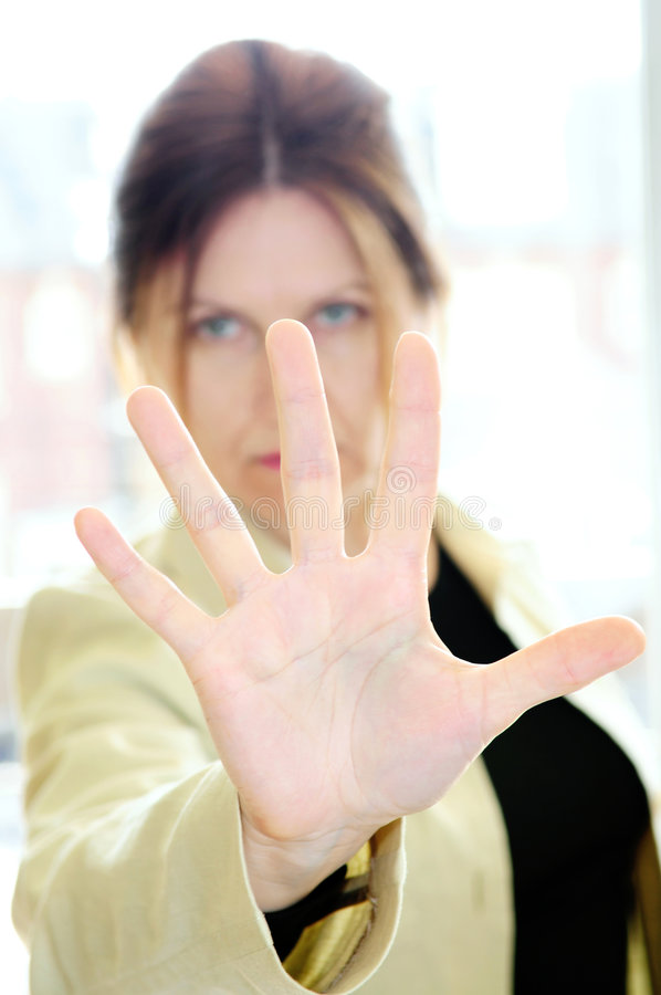 Mature woman gesturing stop royalty free stock image