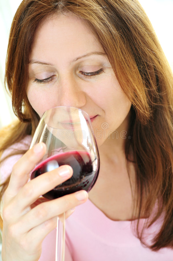 Mature woman with a glass of red wine stock photos