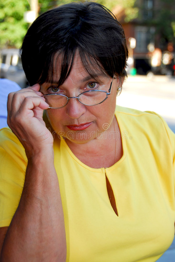 Mature woman glasses royalty free stock image