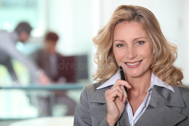 Mature woman in gray suit royalty free stock photo