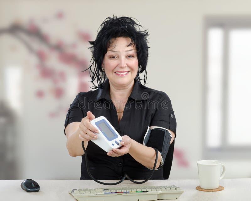 Mature woman has optimal blood pressure stock photography
