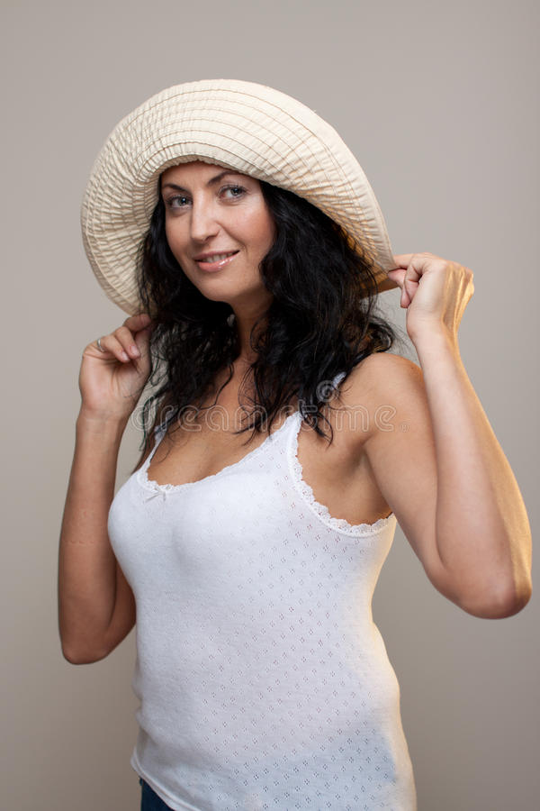 Download Mature woman in a hat stock image. Image of lady, plage - 21610585