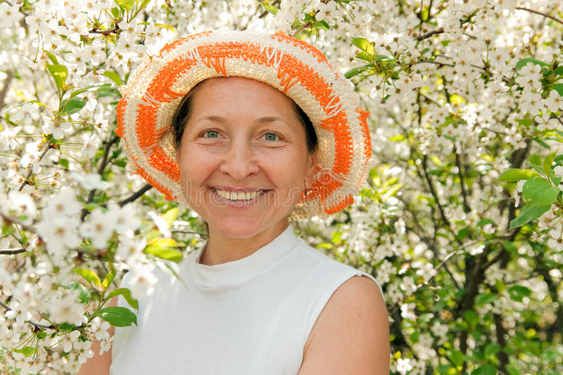 Mature woman in hat stock photography