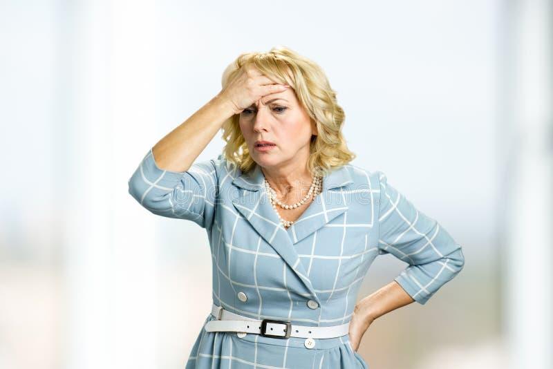 Mature woman having headache. royalty free stock photo