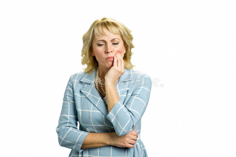 Mature woman having tooth pain. stock image