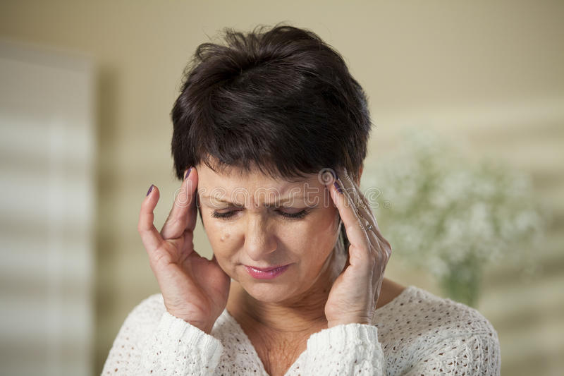 Mature woman with headache stock photography