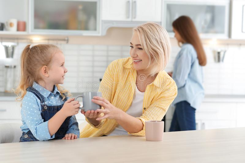 Mature woman, her grandchild and daughter spending time stock images