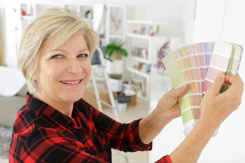 Mature woman holding color swatch stock photography