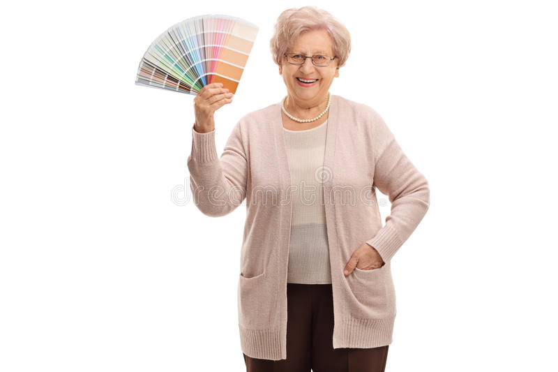 Mature woman holding a color swatch stock photography
