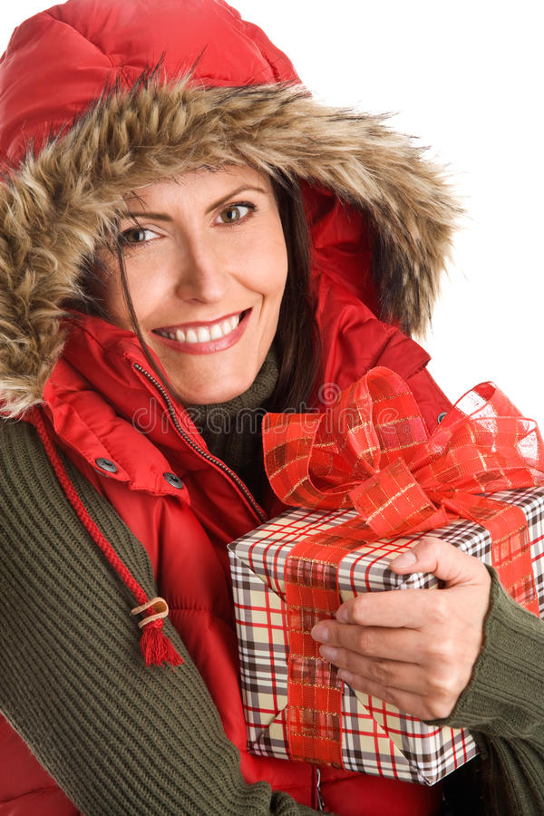 Mature woman holding gift. Portrait of mature beautiful woman holding gift isolated on white background stock images