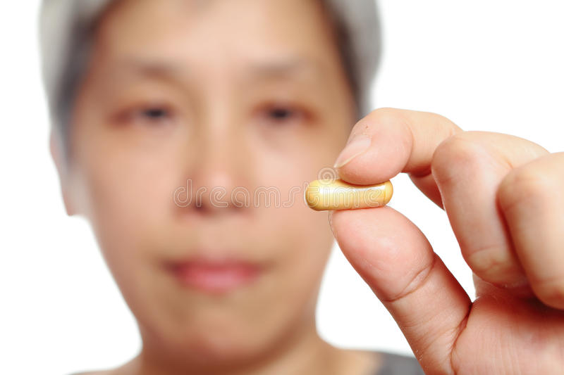 Download Mature woman holding pill stock photo. Image of mature - 21520090