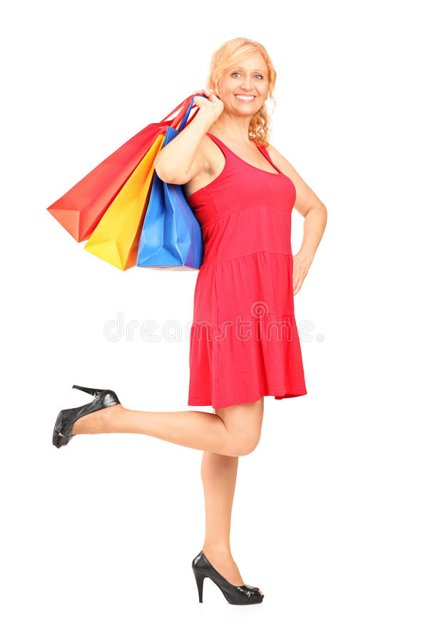 Download Mature Woman Holding Shopping Bags Stock Photo - Image: 26737586