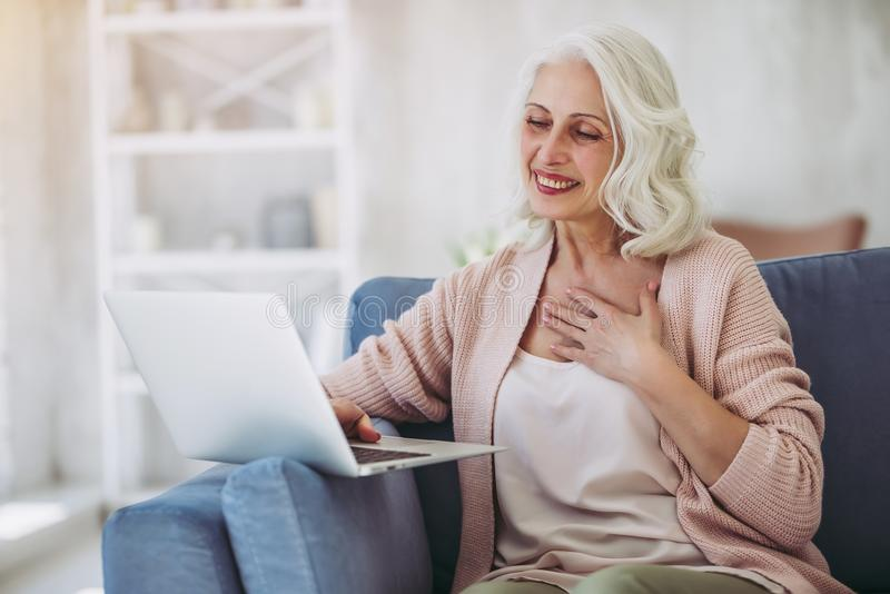 Mature woman at home stock images