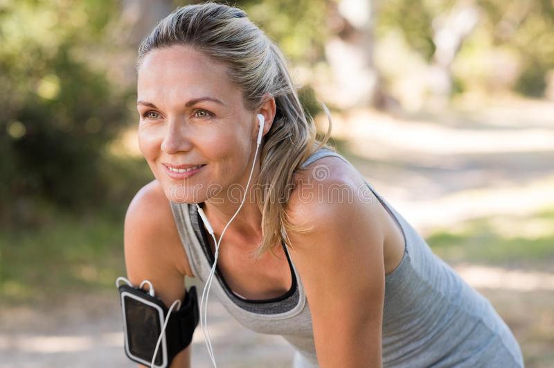 Mature woman jogging stock photos