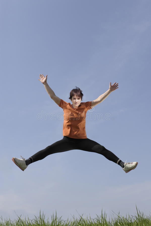 Download Mature Woman Jumping In The Air Stock Photo - Image: 24088908