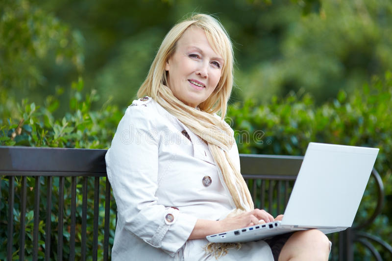 Mature Woman With  Laptop Stock Photography