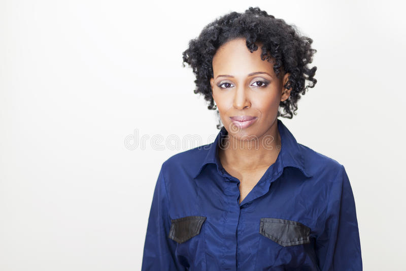 Mature Woman Looking At The Camera Isolated On White. Mature Haitian Woman Looking At The Camera stock photography