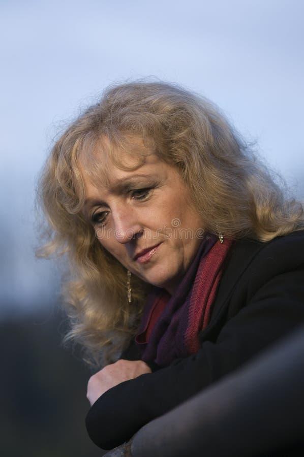 Sad woman looking down royalty free stock photos