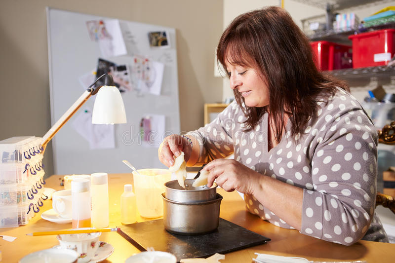 Mature Woman Making Candles At Home stock photo