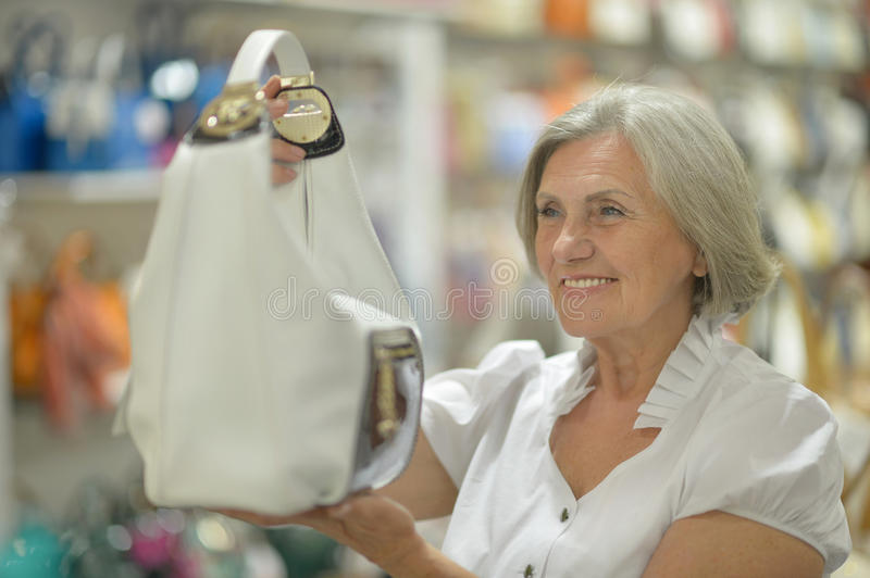 Mature woman in mall. Portrait of a mature woman in mall do shopping stock photo
