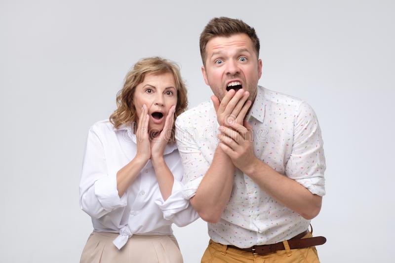 Mature woman and man hear shocking news stock image