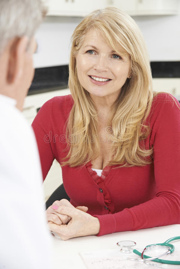 Free Mature Woman Meeting With Doctor In Surgery Stock Photography - 51122952