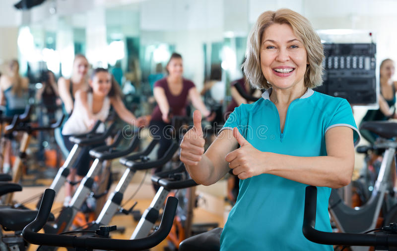 Mature woman in modern gym royalty free stock photography