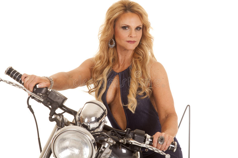 Mature woman open shirt on motorcycle royalty free stock photo