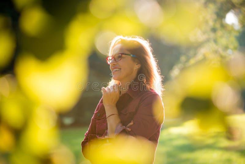 Mature woman outdoor portrait stock image
