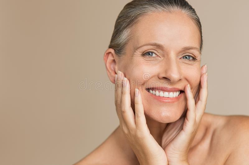Mature woman with perfect skin stock photos
