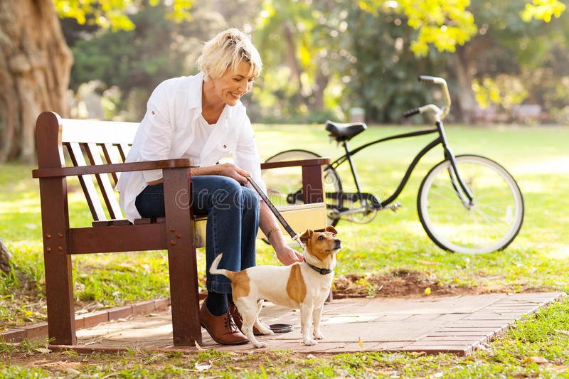 Mature woman pet. Happy mature woman with pet dog outdoors