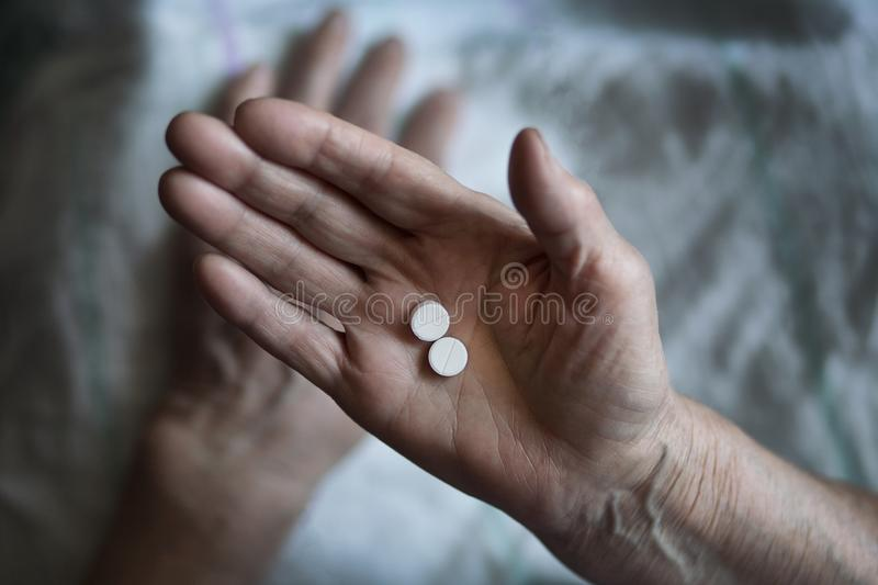 An elderly man drinks a medicine. A pensioner takes a pill medic stock photography