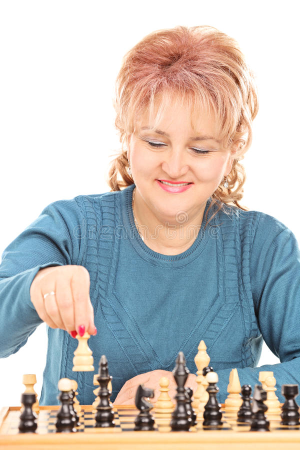 Mature woman playing chess stock image