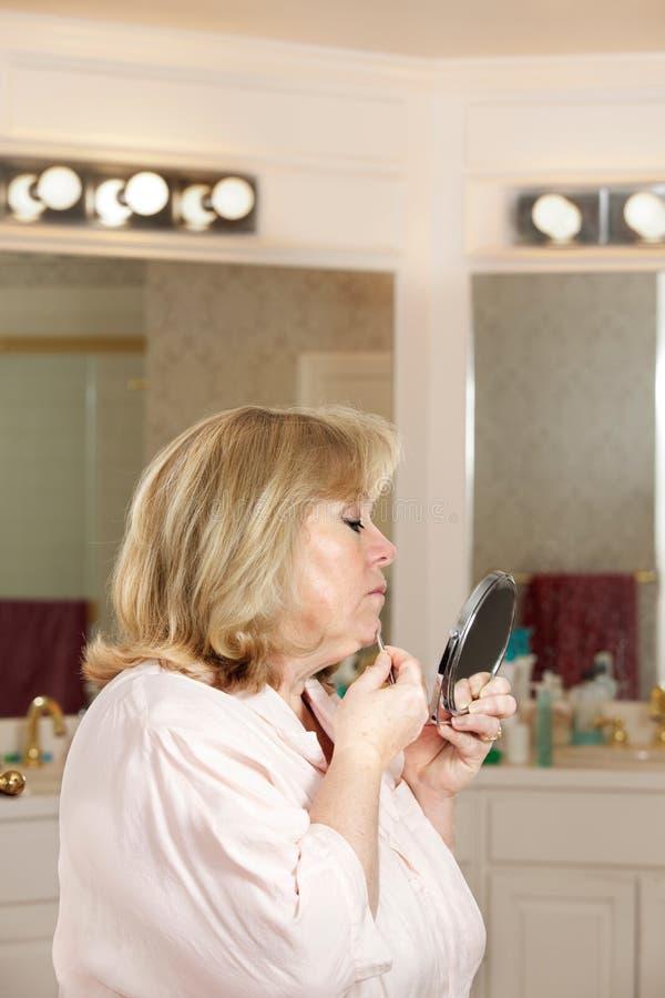 Mature woman plucking hairs
