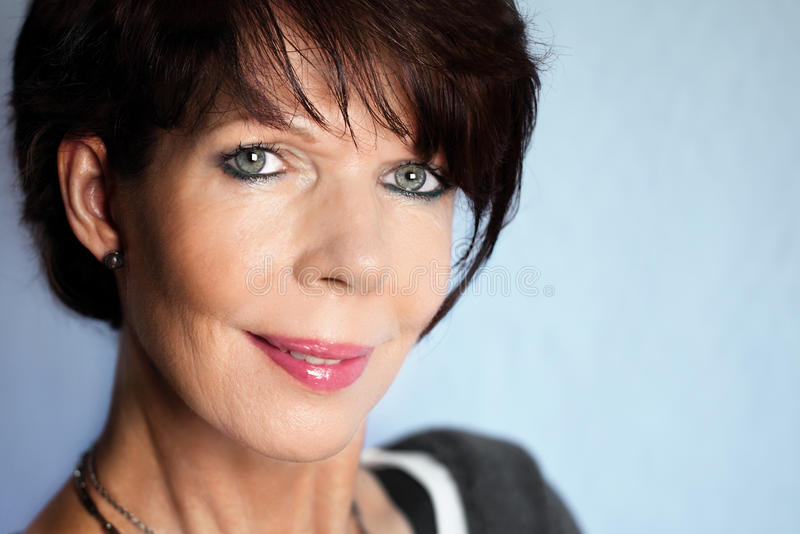 Mature woman portrait with short hair stock images