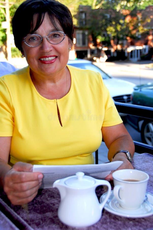 Mature woman reading stock photography