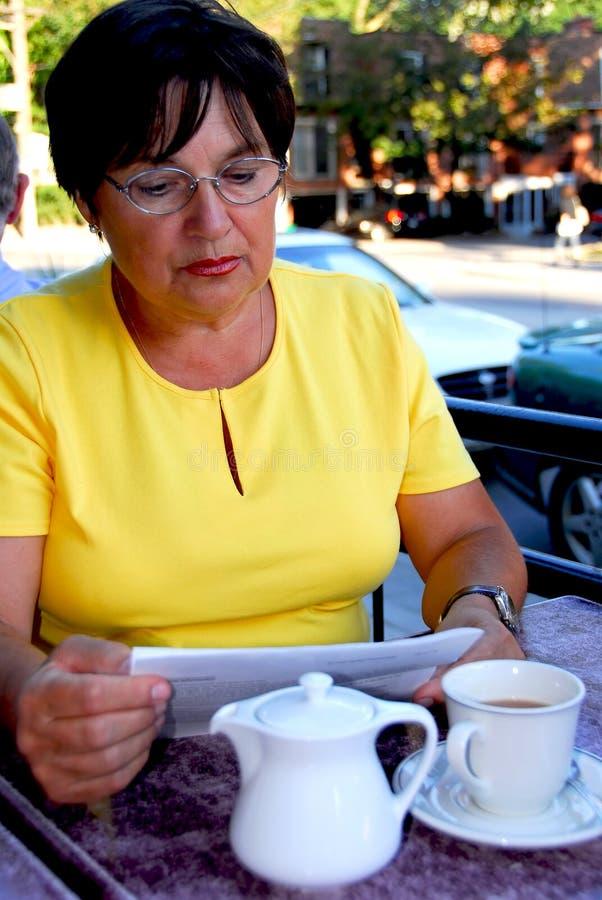 Mature woman reading stock photos