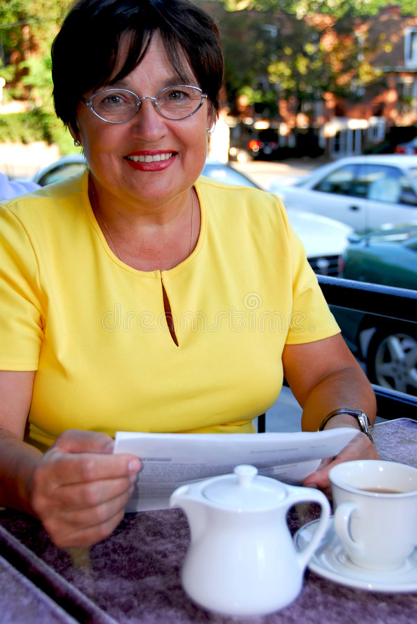 Mature woman reading stock photo