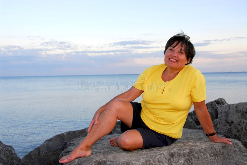 Mature woman relaxing royalty free stock images