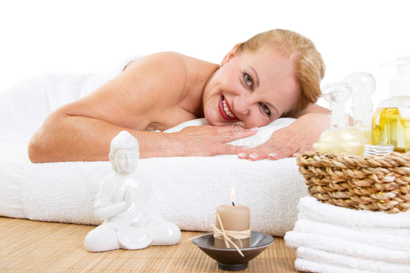 Mature woman relaxing in massage stock photos