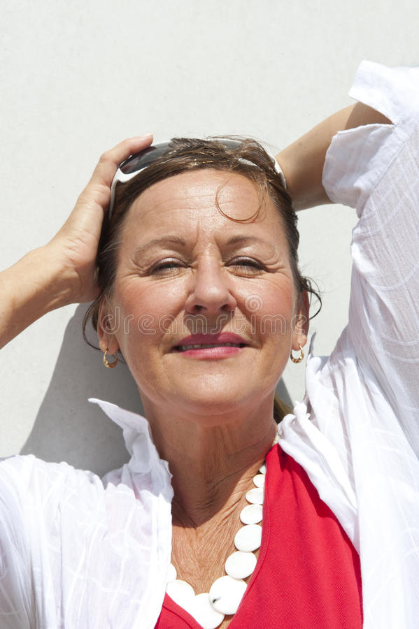 Mature Woman Relaxing on sunny Day royalty free stock image