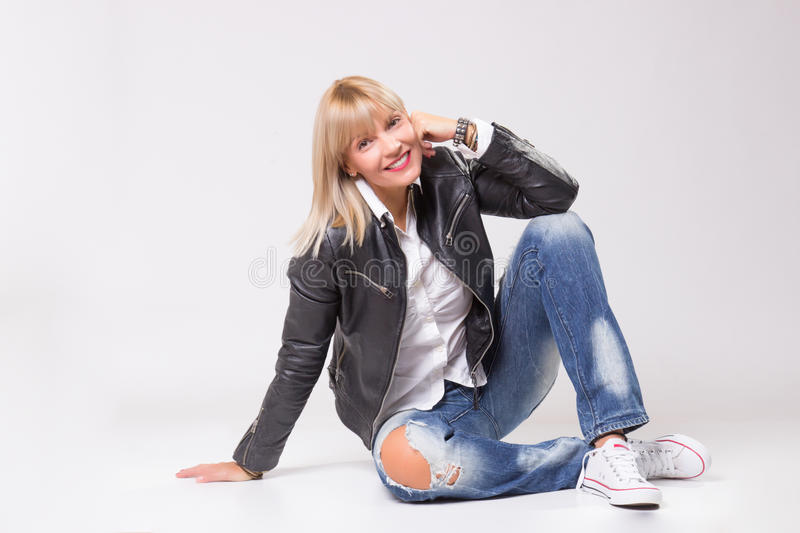 Mature woman 40s sitting casual clothes happy smiling stock photo