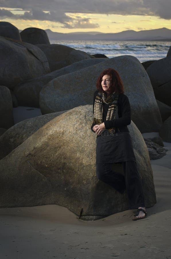 Download Mature Woman At Seaside Rocks Stock Image - Image: 20332201